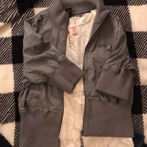 Stretchy material darker grey jacket.